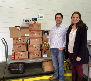 Derek and Brenna next to the scale at the Capital Area Food Bank