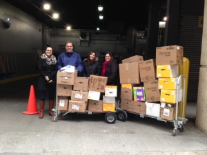Some of the NYC team and the office's donation to Sanctuary for Families